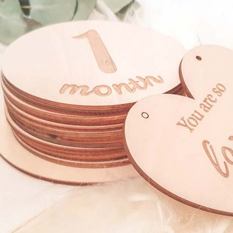 wooden milestone cards with bag